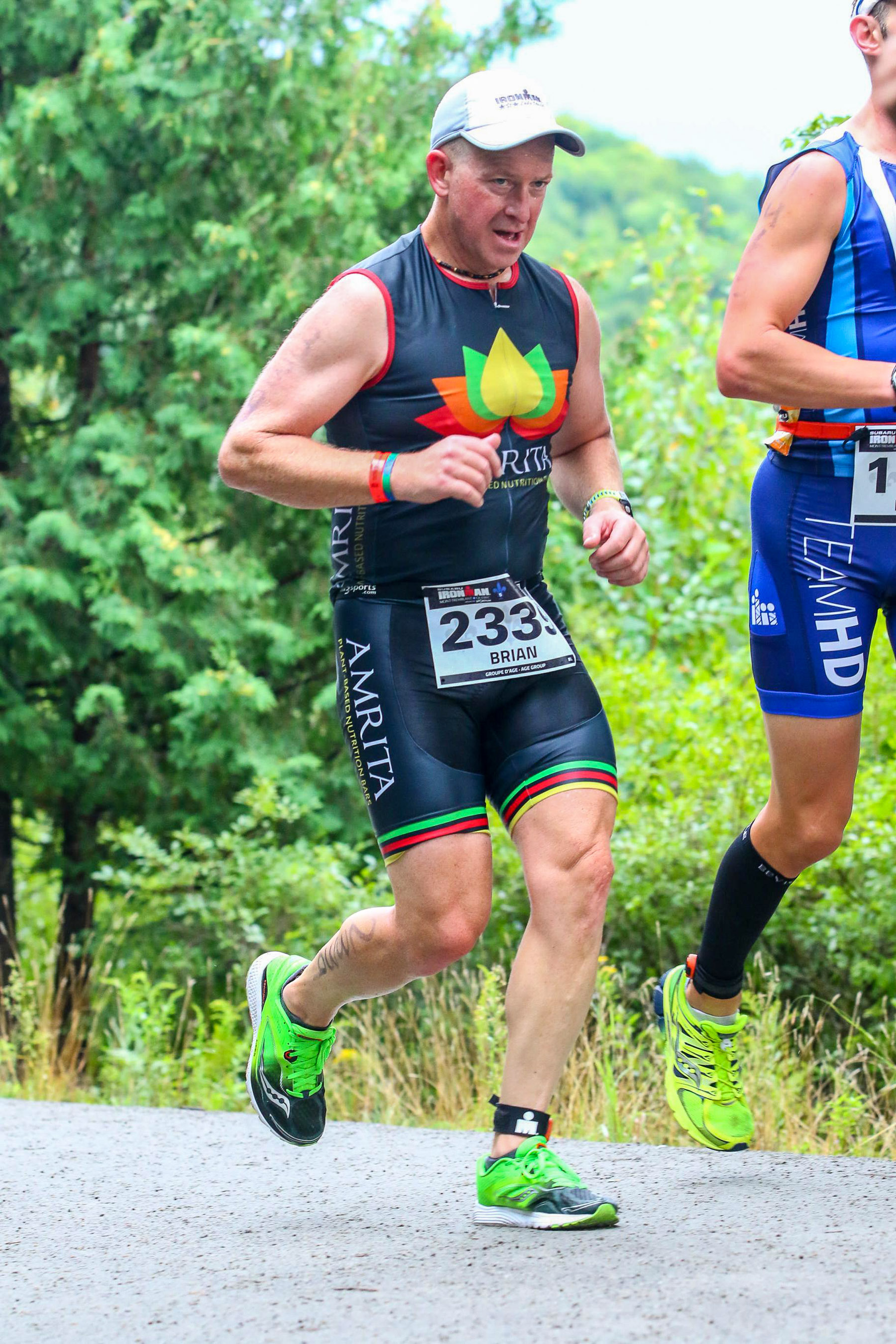 Ironman Mont-Tremblant 2016 - On the run. Must be getting tired here...starting to hunch a bit.